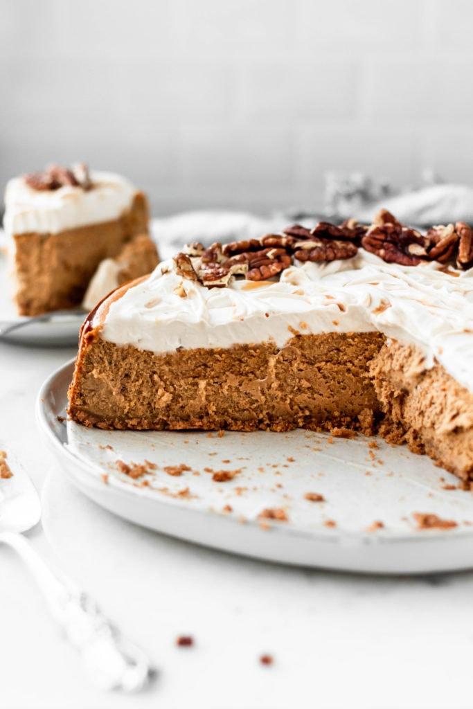 pumpkin pecan cheesecake with caramel whipped cream